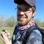 Zack Dempsey holding a songbird