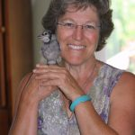 Julie holding her rescued blue jay, Jemima
